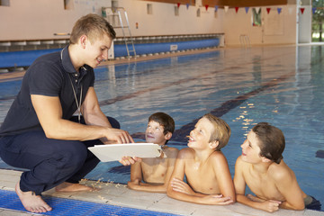 Boys having swimming lesson