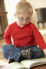 4 year old boy with Downs Syndrome reading