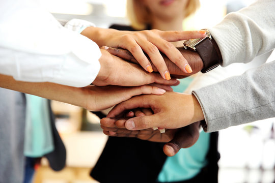 Business people joining hands