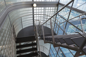 Looking downwards in an open stairwell of a modern building