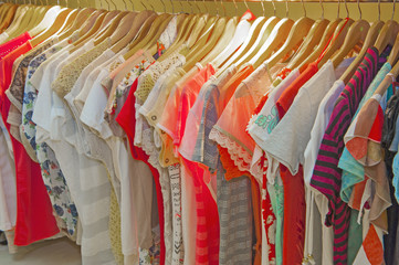 Womens summer clothes hanging on rail