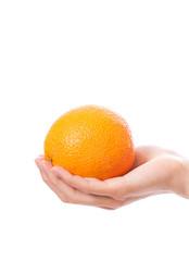 orange in a female hand