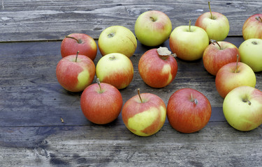 Ripe apples on the wooden table