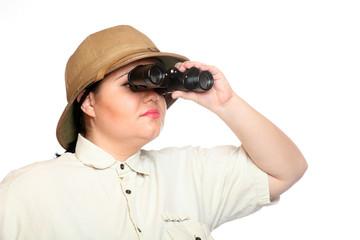 Traveler exploring looking through binoculars .