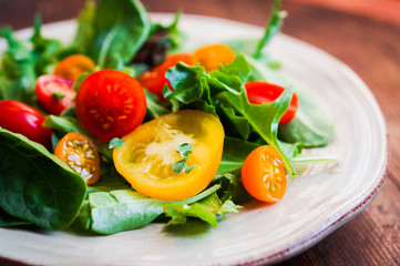 Green salad with colorful tomatoes
