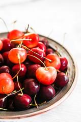 Cherries on rustic background