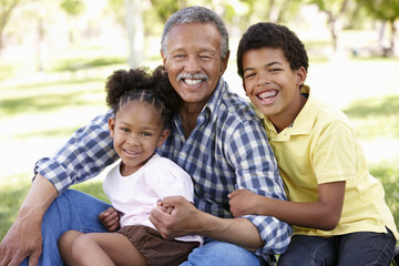 Grandfather and grandchildren in park