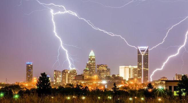 thunderstorm lightning strikes over charlotte city skyline in no