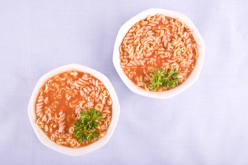 tomato soup with pasta and parsley