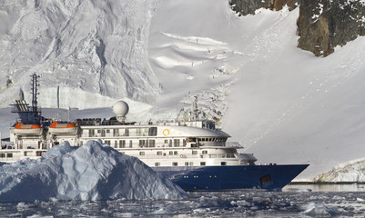 Wall Murals Antarctic tourist ship on the background of mountains and glaciers of the