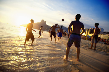 Beach Soccer Brazilians Playing Altinho in the Waves