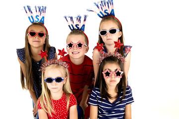 beautiful children wearing patriotic headbands and dark glasses