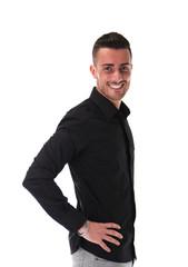 Smiling young man in black shirt, looking at camera