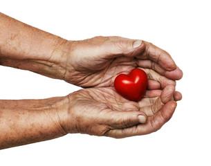 elderly woman keeping red heart in her palms