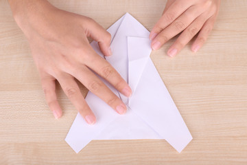 Hands making origami figure, close up