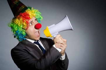 Wall Mural - Clown with loudspeaker in funny concept
