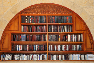 Jewish prayer books on the shelves.