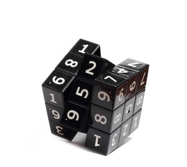 solves Rubik black with white numerals