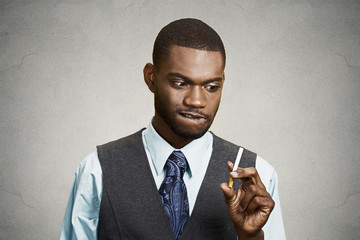 Portrait young business man craving a cigarette, to smoke