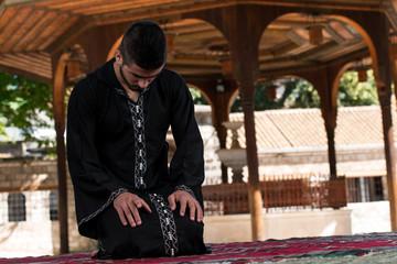 Muslim Man In Dishdasha Is Praying In The Mosque