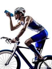 man triathlon iron man athlete cyclist bicycling drinking
