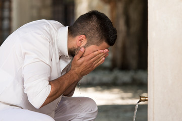 Islamic Religious Rite Ceremony Of Ablution Face Washing