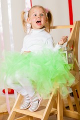 Baby girl in lush color skirt of tulle