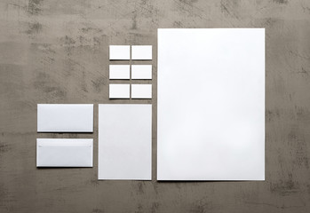 set of corporate identity templates on a gray wall