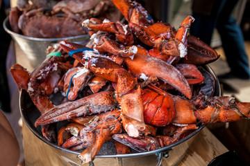 frozen lobster claws in metal bucket at restaurant