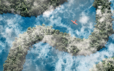 Aerial of red airplane flying over rainforest with river and clo
