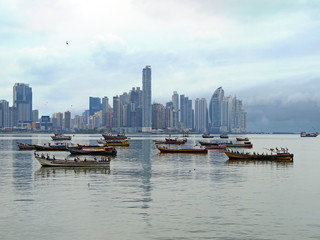 Skyscrapers and fishing boats