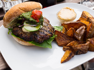 Roasted beef burger and potatoes