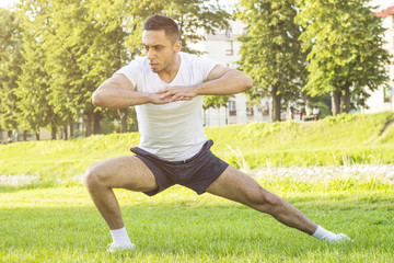 Young male fitness training outdoors