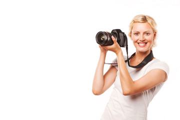 Young smiling woman with photo camera, on white background