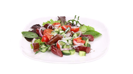 Fresh salad with sausage.