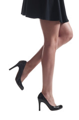Businesswoman legs in high heels and skirt