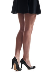 Businesswoman legs in high heels shoes and skirt