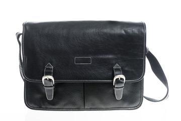Black leather bag isolated.