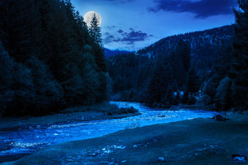 camping place near mountain river at night