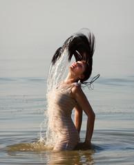woman in the sea splashing water