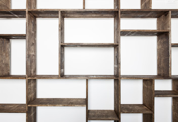 Rustic style shelves on white wall