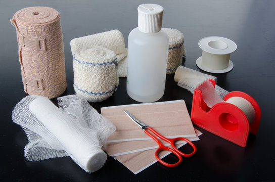 Different rolls of medical bandages and care equipment