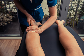 Woman getting leg massage
