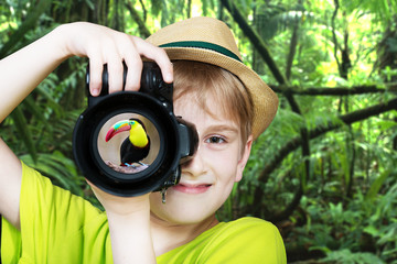 Young photographer with a camera, jungle backround