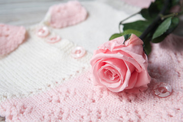 pink roses on a baybe sweater