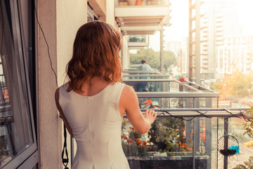 Young woman relaxing on her balcony