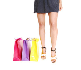 Woman's legs with bag's.