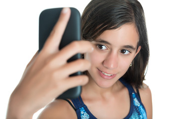 Hispanic teenage girl taking herself a photo