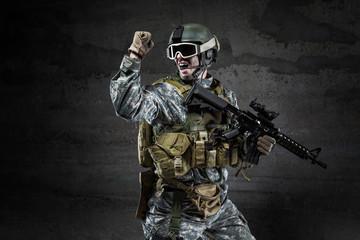 American Soldier shouting on dark background