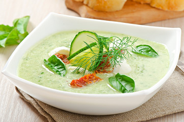 Cold cucumber soup with dried tomatoes and mozzarella